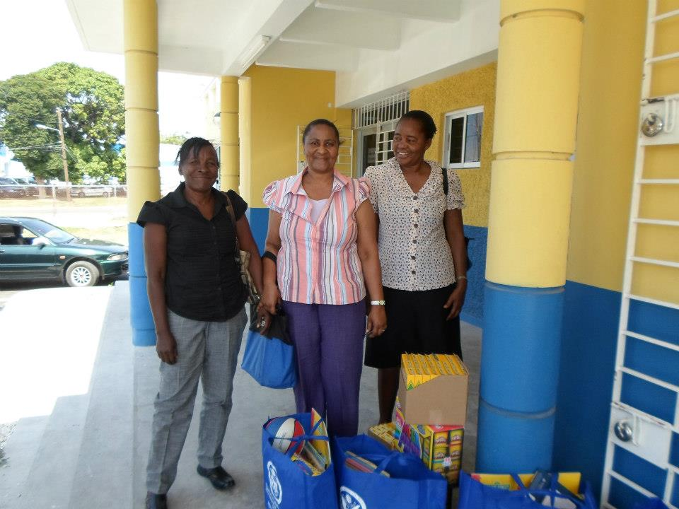 Teachers bursting with smiles after receiving learning kits