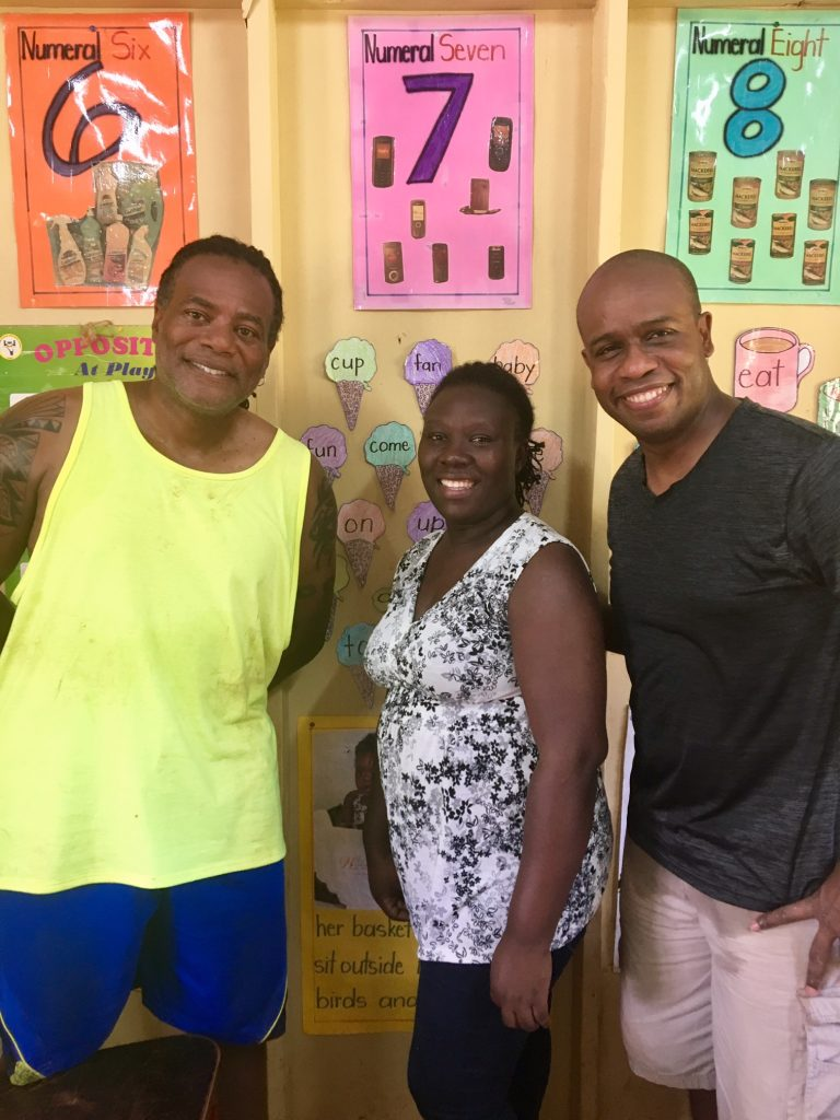 L to R: James Weldon, Ms. Kenisha Daye, Marlon Hill inside Ms. Daye's classroom