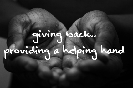 image of hands and text of the words 'giving back'